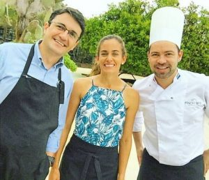Emilio and guests during a cooking class