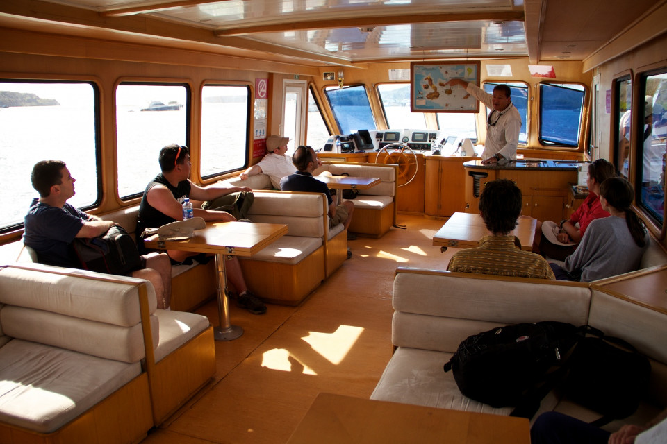 Guide briefing guests aboard the Sea Lion yacht