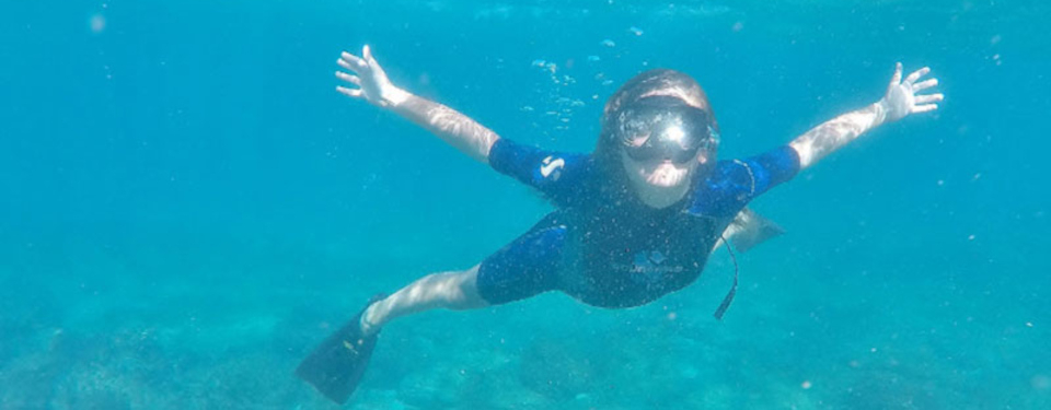 kid-swimming-galapagos-island-1.jpg