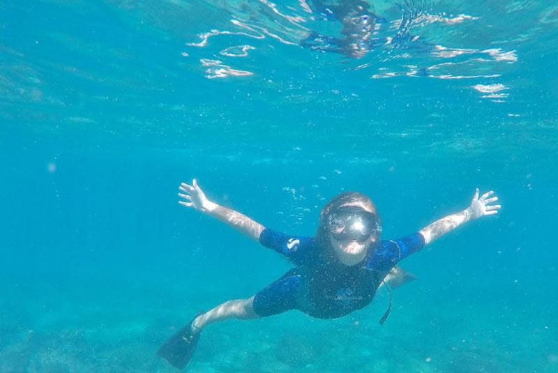 kid-swimming-galapagos-island.jpg