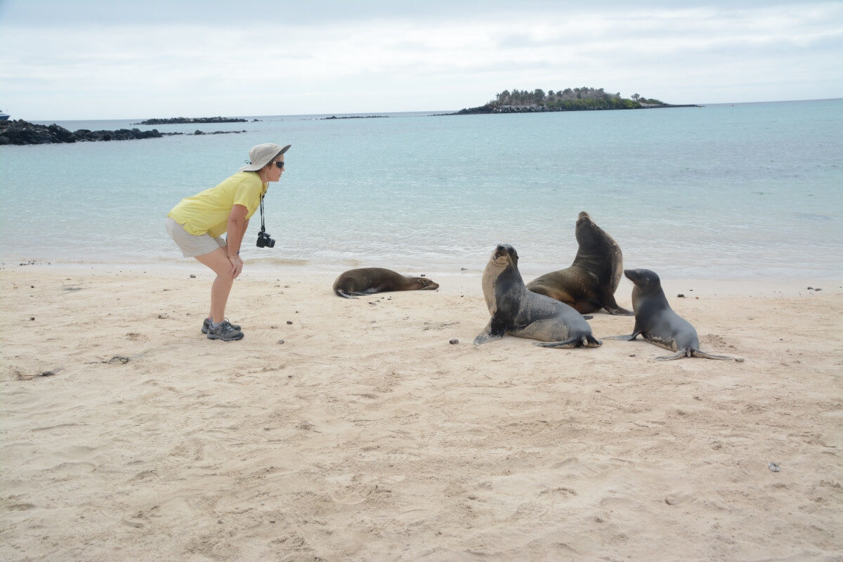 Finch Bay's guest with Galapagos sea lions on Sant Fe Island.