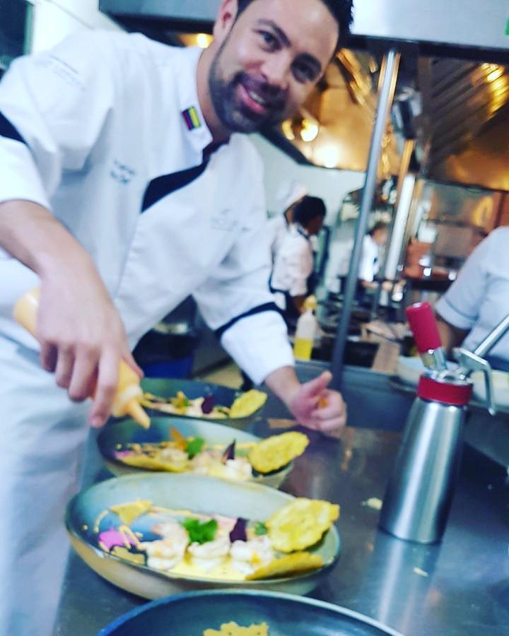 Chef Emilio Dalmau doing what he does best