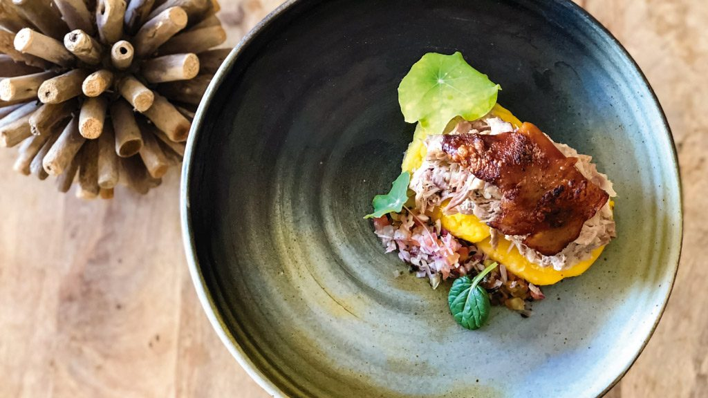 """One of Finch Bay's dishes decorated with herbs from the """"Chakrita"""""""