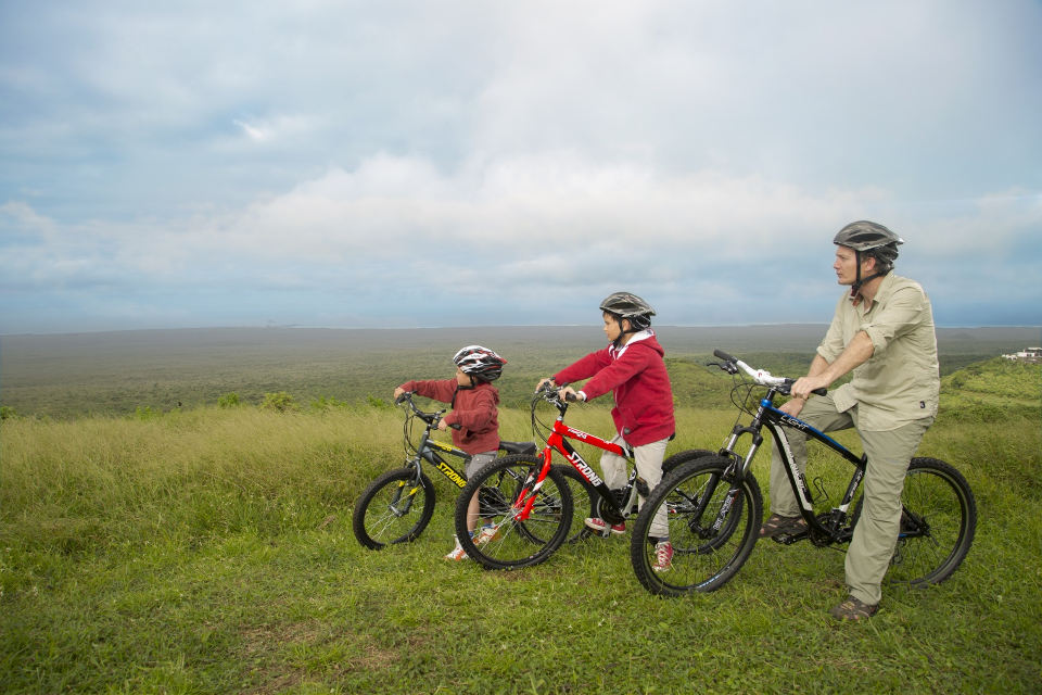 Family biking on Santa Cruz in Galapagos.
