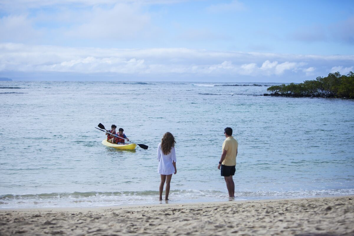 Kids kayaking in the Galapagos Islands.
