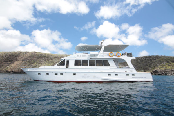 Sea Lion yacht navigating around Bartolome Island.