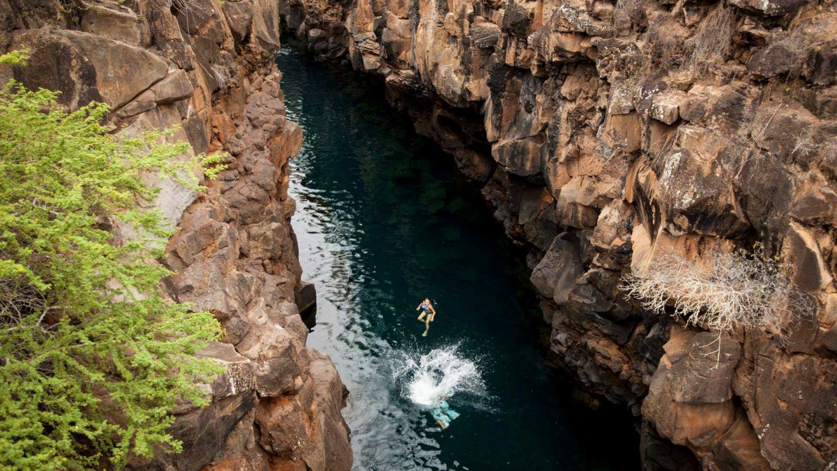 Swimming in las Grietas, a natural pool in the Galapagos Islands