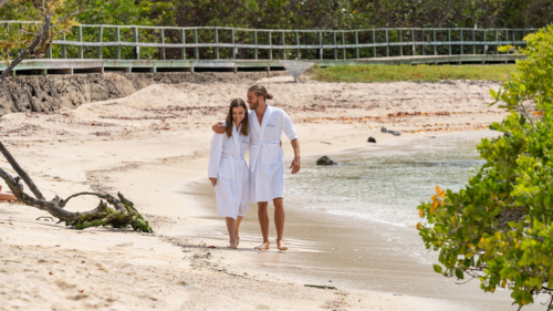 A couple walking around the beach outside the Finch Bay Spa in the Galapagos Islands