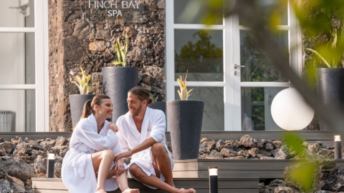 A happy couple outside the Finch Bay Spa in the Galapagos Islands