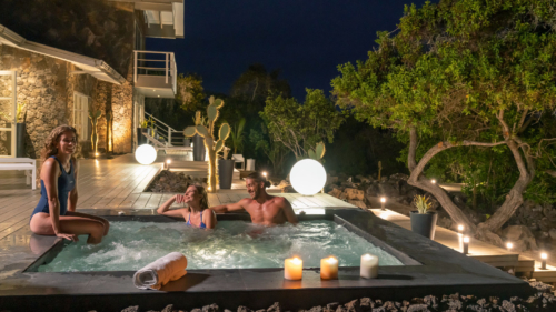 Guests having fun in our hot tub at the Finch Bay Spa in the Galapagos Islands