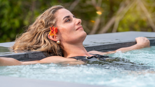 Woman in our Finch Bay Spa hot tub in the Galapagos Islands