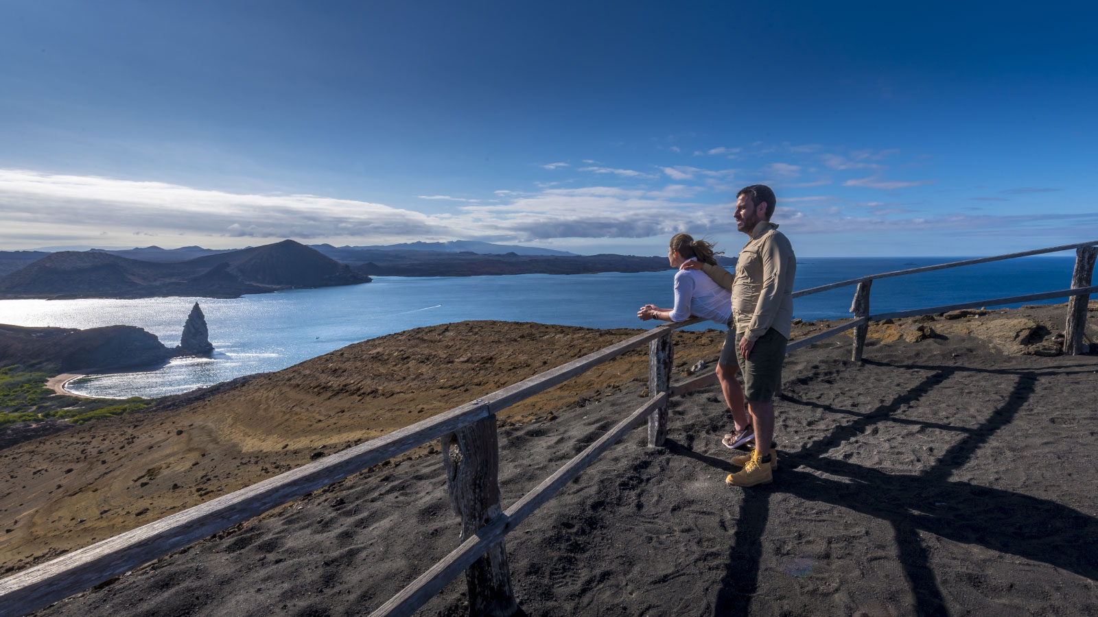 Two couples in Bartolome island enjoying a private vacation in the Galapagos Islands