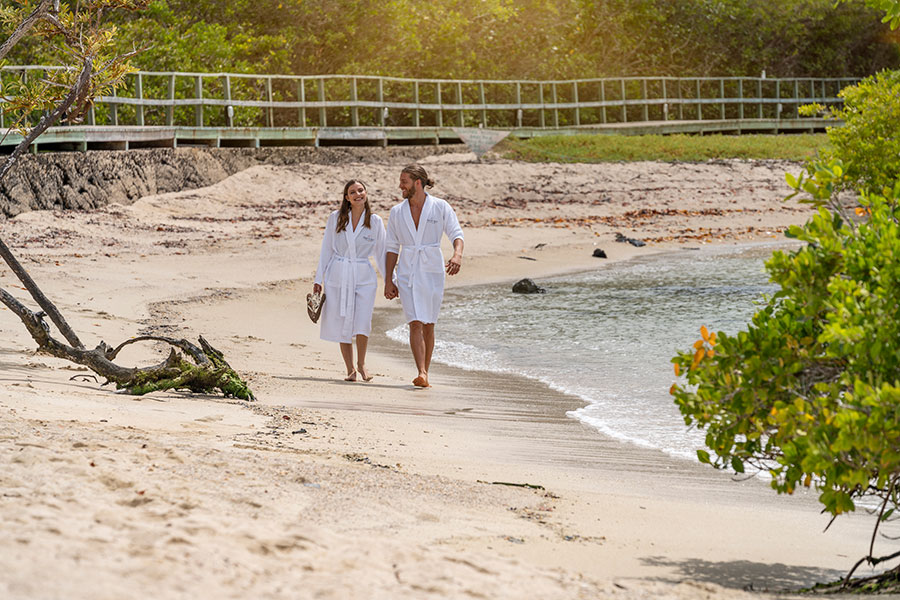 Couple enjoying Los Alemanes Beach, right across the Finch Bay Galapagos Hotel