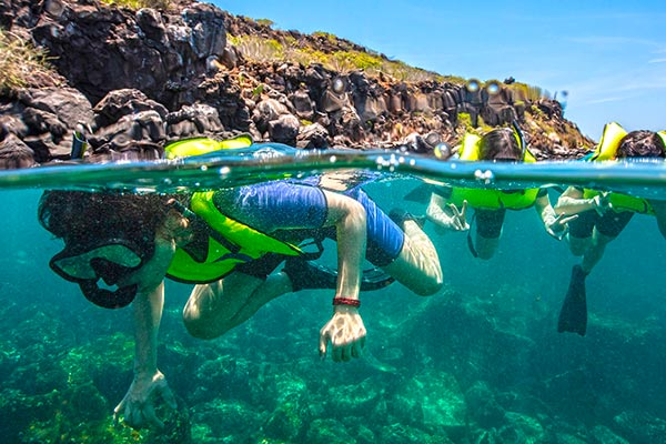 Family snorkeling in the Galapagos Islands